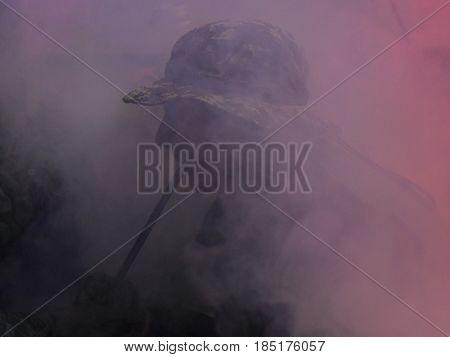 Closeup of a man smoking a hookah in clouds of fume