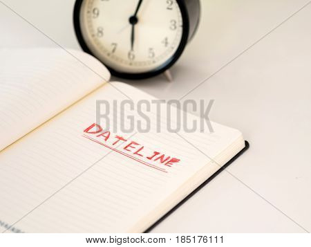 Notebook With Dateline Written With A Clock