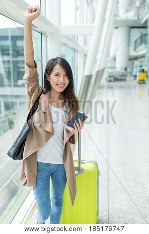 Happy woman go travel with cellphone and luggage