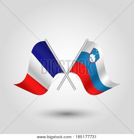 vector two crossed french and slovenian flags on silver sticks - symbol of france and slovenia
