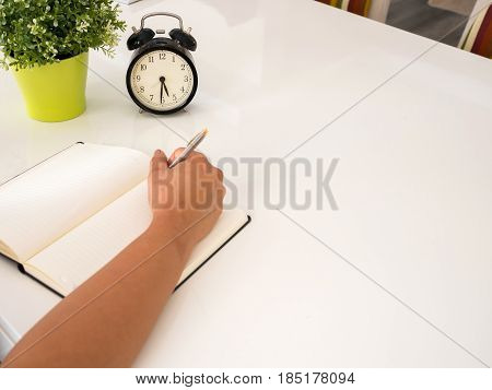 Hand Writing On A Notebook On  A Table