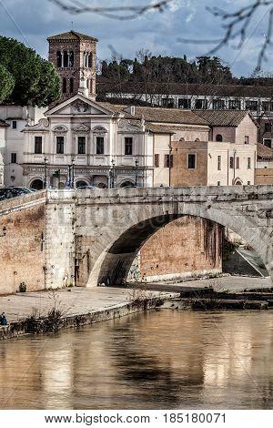 ROME, ITALY. February 19, 2016: Basilica St. Bartholomew, Pons Cestius, Tiber Island and river. Rome, Italy