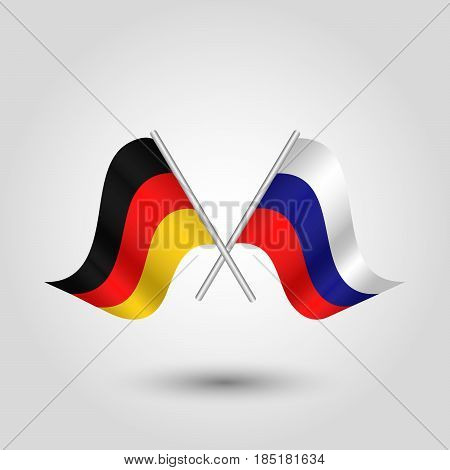 vector two crossed german and russian flags on silver sticks - symbol of germany and russia