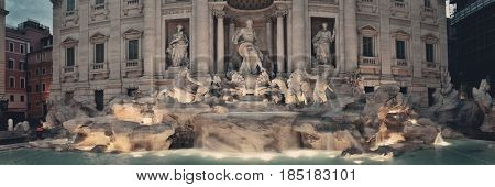 Trevi Fountain closeup panorama with Baroque style as the famous tourism attraction in Rome, Italy.
