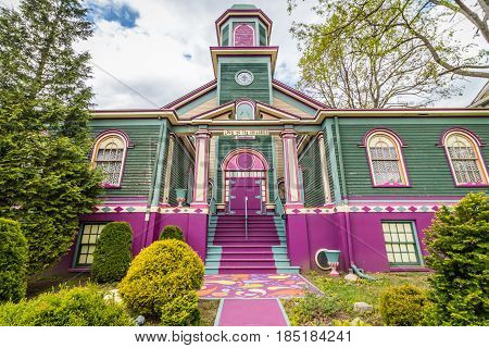 Unique and unusual house converted to theater in interesting colors of purple