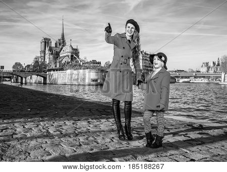Mother And Child Travellers In Paris Pointing At Something