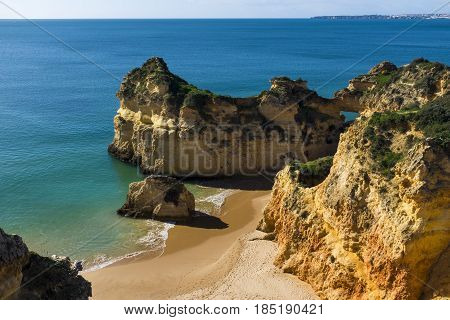 View of the scenic Praia dos Tres Irmaos in Alvor Algarve Portugal; Concept for travel in Portugal and explore Algarve