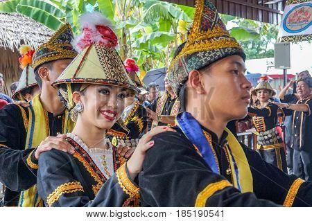 Penampang,Sabah-May 30,2016:Group of Sabah,Borneo Kadazandusun ethnic in their traditional costumes performs traditional dance during Harvest Festival at Penampang,Sabah,Malaysia