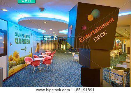 SINGAPORE - CIRCA AUGUST, 2016: Entertainment deck sign at Singapore Changi Airport. Changi Airport is one of the largest transportation hubs in Southeast Asia.