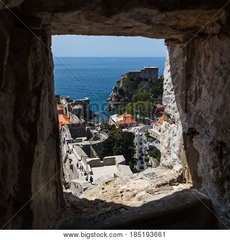 The perfectly preserved medieval town of Dubrovnik surrounded by a rugged perimeter wall.