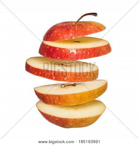 Flying apple. Sliced red apple isolated on white background. Levity fruit floating in the air.