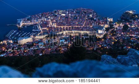 Long exposure of Dubrovnik's old town pictured during twilight from the peak of Srd Hill.