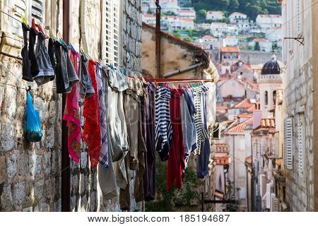Laundry Drying Above A Narrow Street