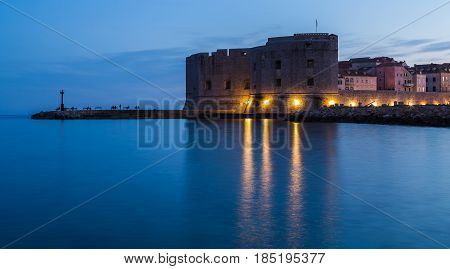 The blue hour/twilight hour descends on the imposing structure of St John's Fortress located at the entrance of Dubrovnik's port.