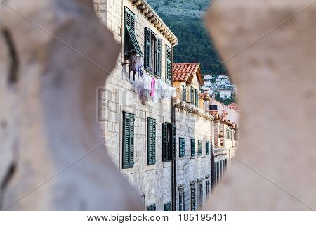 Uniformed colours of the buildings in Dubrovnik's old town. While the upper levels are residential the ground floors are used as shops cafes and restaurants.