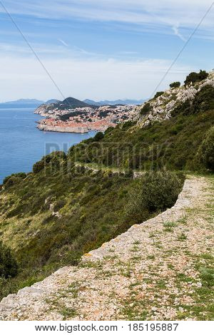 Stone path leads downhill from Park Orsula towards the historic town of Dubrovnik.