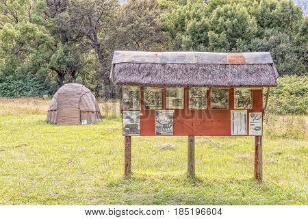 GENADENDAL SOUTH AFRICA - MARCH 27 2017: A Khoi hut and information board at the Khoi kraal at the mission in Genadendal. Genadendal is the first mission station in South Africa founded 1738