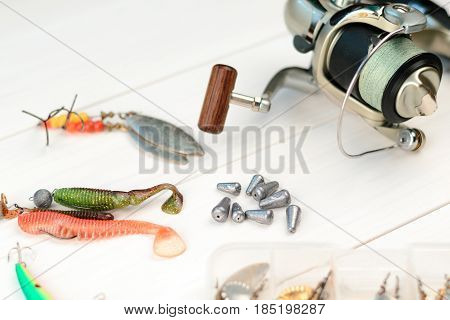 Fishing Rod With Reel, Spoon Baits, Tackles And Wobblers In Box For Catching Or Fishing A Predatory
