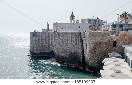 Acre Israel - April 20 2017 : Fragment of remains of the fortress wall in Old Acre Israel