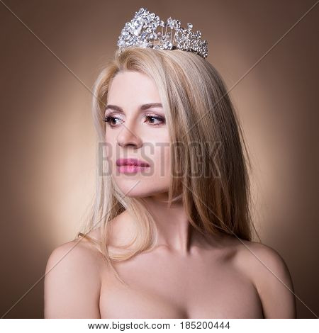 Portrait Of Beautiful Bride With Crown Over Beige