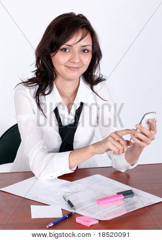 portrait of attractive businesswoman touching mobile phone