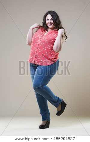 Plus size fashion model in casual clothes fat woman on beige studio background overweight female body full length portrait