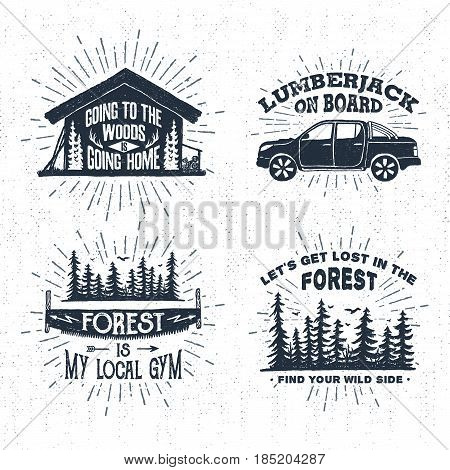 Hand drawn vintage badges set with textured wooden cabin pickup truck saw and spruce forest vector illustrations and inspirational lettering.