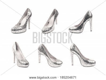 Shining silver high-heeled footwear shoe isolated over the white background, set of six different foreshortenings