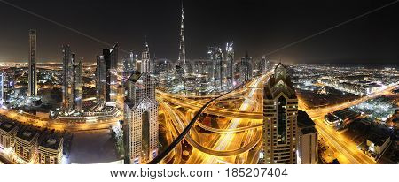 Dubai panorama with the tallest building in the world Burj Khalifa near busy Sheikh Zayed Road in the late evening
