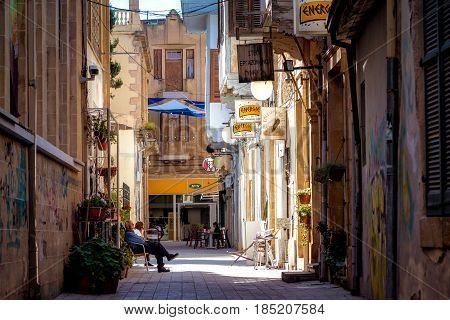 NICOSIA CYPRUS - MARCH 24 2017: View through the Sokratous street and the intersection with Ledra street in the old town of Nicosia