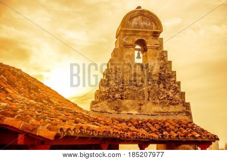 View on sunset over Stone Tower of Castillo in Cartagena poster