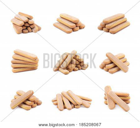 Pile of multiple ladyfinger savoiardi biscuit cookies, composition isolated over the white background, set of six different foreshortenings