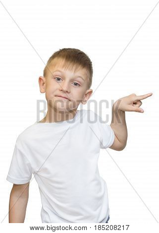 Emotional portrait of caucasian teen boy. Funny teenager pointing and looking upwards while laughing isolated on white background.