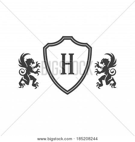 Heraldic lions and monogram on shield Isolated on white background vector icon in retro style. Can be used for crest logo or heraldic badge.