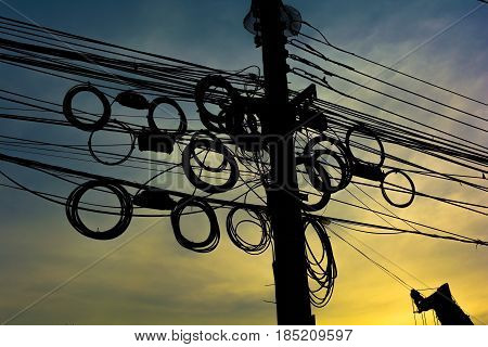 Mess of wiring on the power poles. Confusion concept.