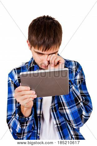 Sad Young Man with Tablet Computer Isolated on the White Background