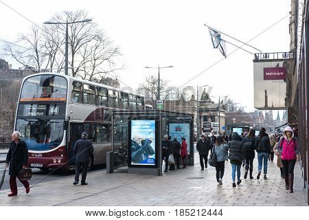 Edinburgh, United Kingdom. 2 February 2017 : People Walking On The Street, With Car, Building In Bac