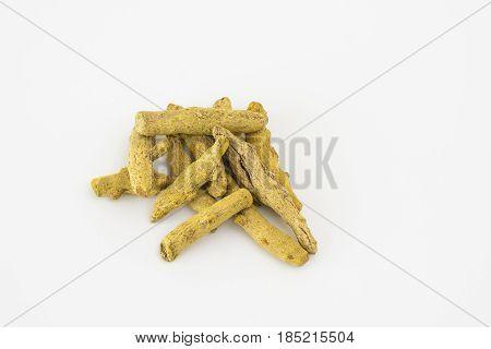 Dried turmeric sticks (Curcuma longa) on a white background