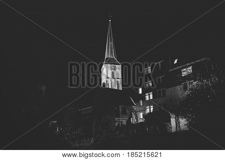 Illuminated church tower of the upper church in the Hanseatic city of Kampen Overijssel Netherlands by Night