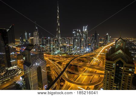 Dubai skyline with the tallest building in the world Burj Khalifa near busy Sheikh Zayed Road in the late evening