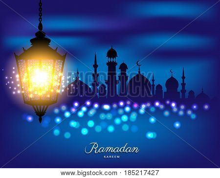 Beautiful bright lamp with Mosque silhouette for ramadan of Islam