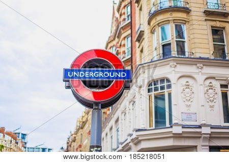 Underground Sign In Central London With Architecture Bokeh