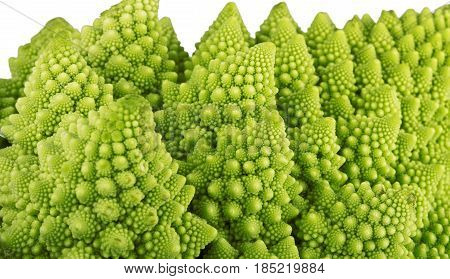 Roman broccoli vegetableclose up on the white