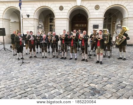 LVIV UKRAINE - APRIL 25: The brass restr (orchestra) from Austria is playing in front of city Hall in Lviv on April 25 2017 in Lvov Ukraine