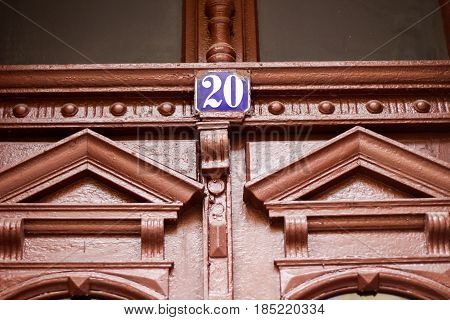House Number Plate Hanging Outside The Beautiful Building With Brown Pattern Decoration Building On