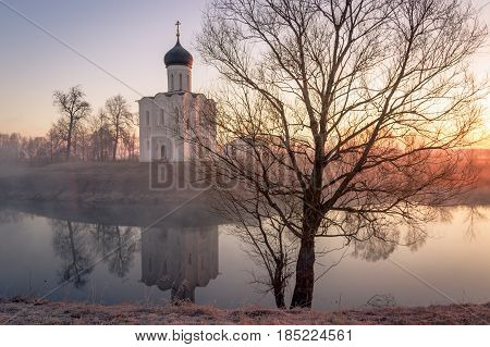 View to the Church of the Intercession of the Holy Virgin on the Nerl River in sunlight