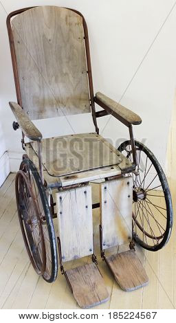 A Vintage Wooden Rolling Chair Now Known as Wheelchair