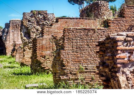 Ancient Roman brick structure ruins background. Roman Forum in Rome, Italy.