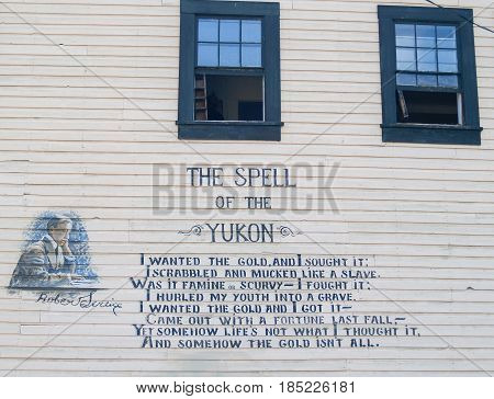 Dawson City, Canada - August 4, 2008; Poetry of Robert Service on wall of Dawson City building TheSpell of the Yukon