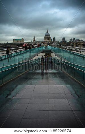 walking on millennium bridge in london in england